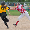 Mankato West's Emily Veroeven (9) reaches out to tag Torey Richards (13) of Mankato East as she ran to second base. West won the playoff game played at Caswell Park 6-3. Photo by Jackson Forderer