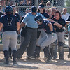 St. Peter's Alexandra Zachman jumps onto home plate surrounded by her teammates after she hit a home run against Jordan in a Section 2AA softball playoff game. The Saints won the game 3-0 to advance to the section's championship game. Photo by Jackson Forderer