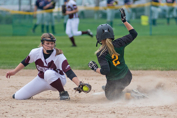 McKenna Berdan (left) of New Ulm Cathedral tries to put a tag on Sleepy Eye St. Mary's Jody Hansen (2) at second base. Hansen was called safe on the play. Cathedral lost a lopsided game 16-1 in the Section 2A playoffs. Photo by Jackson Forderer