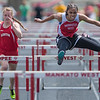 Aliyah Dawkins (right) of Mankato West clears the second to last hurdle in the finals of the 100 meter hurdles during the Big Nine track meet on Thursday. Dawkins won the race with a time of 16.77 seconds. Photo by Jackson Forderer