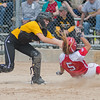 Mankato East's Torey Richards (left) tags out Tristin Danay (5) of Mankato West at home plate in a Section 2AAA playoff game on Saturday. West won the game 6-3. Photo by Jackson Forderer