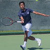 St. Peter's Rafat Solamain chases down a forehand in a doubles match against Rochester Lourdes on Friday. Solamain and his doubles partner Drew Elofson won the Section 1A doubles tennis tournament to earn a berth in the state tournament. Photo by Jackson Forderer
