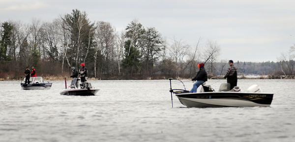 John Cross<br /> A few brave anglers fish open water on Upper Whitefish Lake near the mouth of the Pine River on Saturday. H