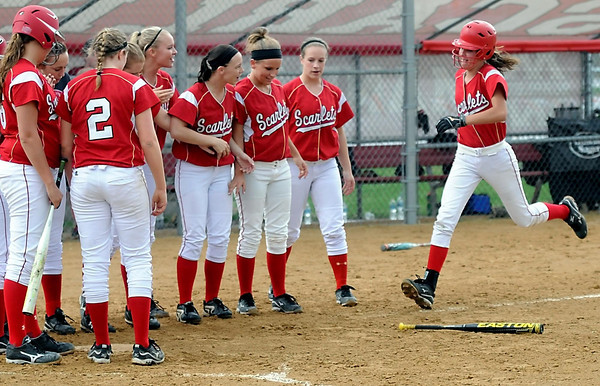 Pat Christman<br /> Mankato West's Lexy Schoper is greeted by her teammates after hitting a solo home run during the third inning of their game against Albert Lea Wednesday at the West field.