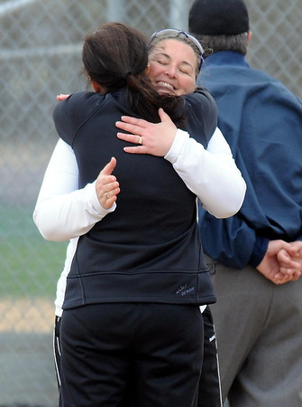 Pat Christman<br /> Maple River softball coach and former Mankato Loyola coach Laura Olson hugs current Loyola coach Jessica Kirschner before their game Thursday at the Loyola field.