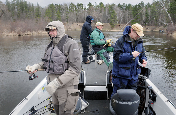 John Cross<br /> From left, Gary McCreary, Tim Suhr, Brian Fowler and Larry McCreary are bundled against 40 degree temperatures Saturday as they fish the Pine River near Cross Lake on the Minnesota fishing opener.
