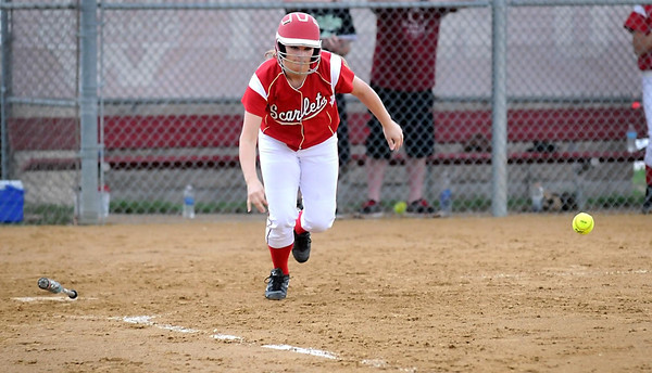 Pat Christman<br /> Mankato West's Anna Crooker lays down a bunt during their game against Albert Lea Wednesday at the West field.