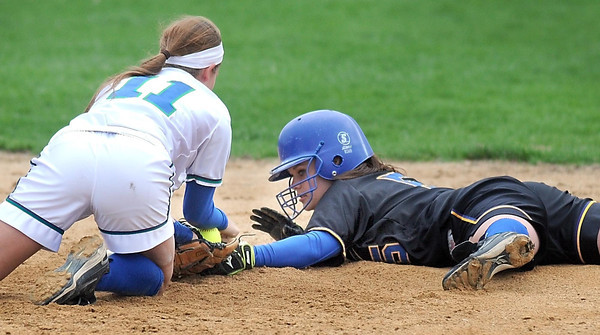 Pat Christman<br /> Mankato Loyola's Maddie McCargar slides into second base ahead of the tag by Maple River's 11 during their game Thursday at the Loyola field.