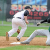 Pat Christman<br /> Rochester Mayo's Ryan Martin slides into second as Mankato East's Jordan Grams, left, and Tyler Substad field a ground ball during the first game of their doubleheader Thursday at Wolverton Field.