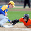 Pat Christman<br /> Mankato Loyola's Andrew Sweere can't get the tag on Cleveland's Tyler Seitz before he makes it back to first base during their game Saturday at Franklin Rogers Park.