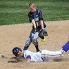Pat Christman<br /> Minnesota State's Samanthan Holien slides into second ahead of the throw to Augustana's Jenny Brown during their NCAA Division II Central Region tournament game Friday.