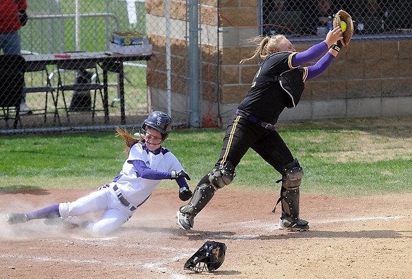 Pat Christman<br /> Winona State's Jordan Petersen scores ahead of the throw to Minnesota State catcher Lindsay Erickson during the second inning of their first game Saturday in the NCAA Division II Central Region tourament.