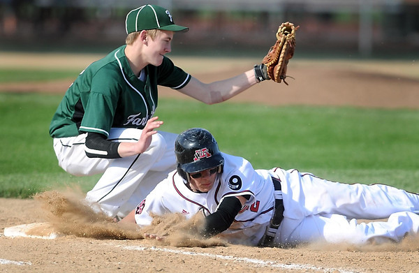 Pat Christman<br /> Mankato West's Devin Ries plows dirt in front of him as he dives safely back to first base during the first game of a doubleheader against Faribault Friday at Franklin Rogers Park.