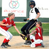 Pat Christman Mankato East's Allison Taylor gets to second base ahead of the throw to Mankato West's Malorie Veroeven, left, and Kinzie Scearcy during their game Tuesday at Thomas Park.
