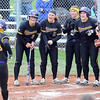 Teammates cheer as Minnesota State's Samantha Holien reaches home after hitting a solo home run in the first inning of a NCAA Division II Central Region tournament game Friday at MSU. Photo by Pat Christman