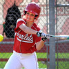 Mankato West's Emily Veroeven takes a swing at a pitch during the second inning of a game against Rochester John Marshall Tuesday. Photo by Pat Christman