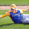 Mankato Loyola's Mark Kortuem makes a diving catch in foul territory during a game against Cleveland Saturday at Franklin Rogers Park. Photo by Pat Christman