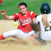 Mankato West's Megan Svir loses the ball after a collision with Mankato East's Shelby Beckman at second base during their game Wednesday at the West field. Photo by Pat Christman