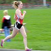 Mankato West's Allison Campbell runs during the 4x800 meter run Tuesday at the West track. Photo by Pat Christman