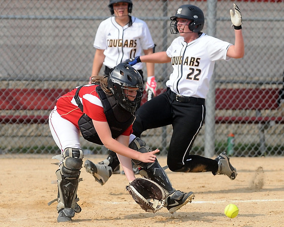 Mankato East's Shelby Beckman beats the throw home to Mankato West catcher Hannah Hastings during the fourth inning Wednesday at the West field. Photo by Pat Christman