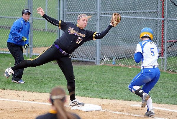 Minnesota State's Ashley Thell reaches to catch the ball to record an out at first base while staying out of the way of Southeastern Oklahoma's Lacie Cook during their NCAA Division II Central Region game Friday at MSU. Photo by Pat Christman