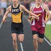 Calvin Rykhus (left) of Mankato East makes contact with Kellen Rodriguez of Fairmont in the last leg of the boys 4x800 meter relay at the Section 2AA True Team track and field meet. The East team was disqualified from the event, leaving Fairmont as the winners of the race. Photo by Jackson Forderer