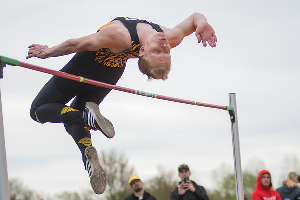 Ben Ziegler of Mankato East clears six feet four inches in the high jump event at the Section 2AA True Team track and field meet. Ziegler took first place in the event. Photo by Jackson Forderer