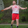 Garrett Shumski of Mankato West throws the discus in the Section 2AA True Team track and field meet held at Mankato East on Thursday. Shumski's longest throw was 158 feet. Photo by Jackson Forderer