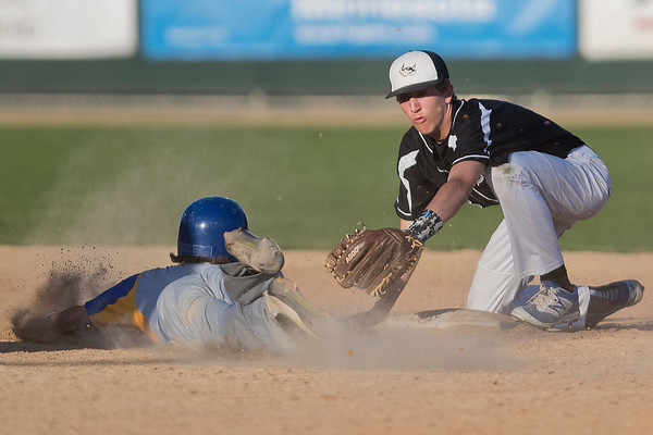 Mankato Loyola's Carter Fogal (left) gets tagged out by Martin County West's Wyatt Geistfeld at second base in Thursday's game played at Franklin Rogers Park. The Crusaders lost 9-8 in extra innings. Photo by Jackson Forderer