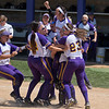 The Minnesota State softball team hoists pitcher Coley Ries in the air as they began their celebration after defeating Augustana 4-3 to win the Central Region II championship on Saturday. The team will next play in the Super Regional. Photo by Jackson Forderer