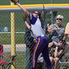 A ball hit by an Augustana player barely flies foul and over the glove of Minnesota State's McKenzie Paap. The Mavericks defeated Augustana 4-3 to win the Central Region II championship. Photo by Jackson Forderer