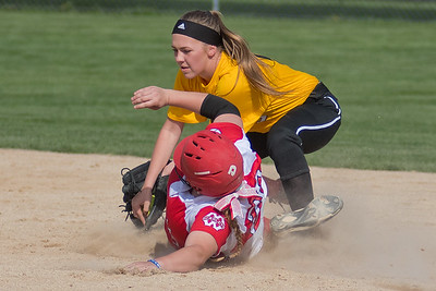 Mankato East's Morgan George tags out Mankato West's Hannah Rode at second base in the conference game played on Tuesday. West won 10-1 to improve their record to 13-1. Photo by Jackson Forderer