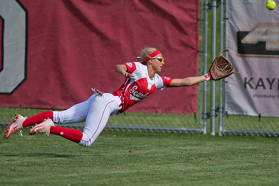 Jenna Helget of Mankato West comes up short in making a diving catch during the Scarlets game against Mankato East. West won the rival game 10-1. Photo by Jackson Forderer