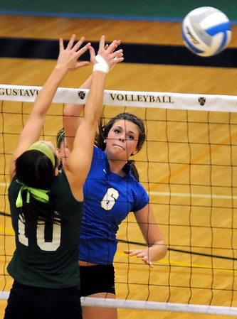 Le Sueur-Henderson's Gabby Thomas hits the ball past Waterville-Elysian-Morristown's Shayna Kinniry during the first game of their match Thursday at Gustavus Adolphus College.