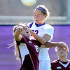 Minnesota State Univesity's Nicole Dooher leaps over University of Minnesota Duluth's Riley Allen to head the ball into the net for a goal during the first half of their NSIC quarterfinal match Wednesday at The Pitch.
