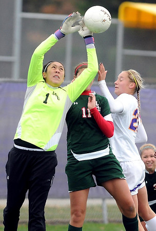 Minot State goalie Marie Torres keeps a corner kick away from Minnesota State's Nicole Dooher (in white) during the first half of their NSIC semifinal soccer match Friday at The Pitch.