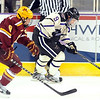 The University of Minnesota's Ryan Reilly chases Minnesota State University's Bryce Gervais during the first period Saturday at the Verizon Wireless Center.