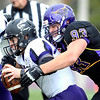 Minnesota State University's Chris Schaudt sacks University of Sioux Falls quarterback Taylor Perkins during the first half Saturday at Blakeslee Stadium. Schaudt recorded three sacks and an interception in MSU's 27-13 win.