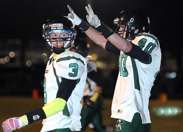 Waterville-Elysian-Morristown's Tucker Kinniry (3) watches as teammate Nicholas Kaplan holds up Brady Hruska's number 2 after scoring a touchdown during the first half of their Section 2AA championship game against Sibley East Friday in Arlington. Hruska died in a hunting accident last week.