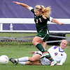 Minnesota State's Tori Meinhardt slides in to kick the ball away from Minot State's Lexy Kidd during the first half of their NSIC semifinal soccer match Friday at The Pitch.