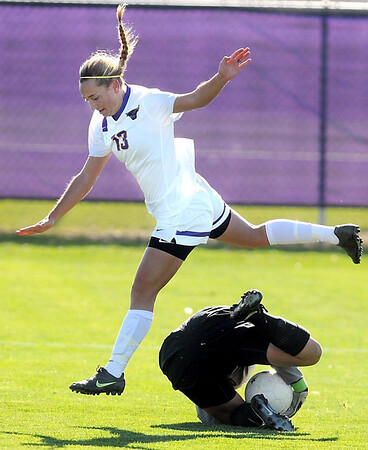 Minnesota State's Korey Kronforst leaps over University of Minnesota Duluth goalie Marissa Rosa during the first half of their NSIC quarterfinal match Wednesday at The Pitch.