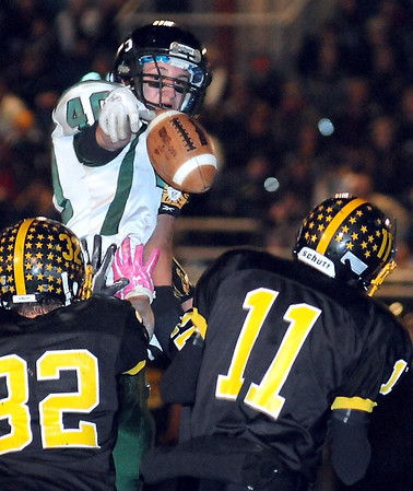Waterville-Elysian-Morristown's Nicholas Kaplan knocks down a pass by Sibley East quarterback Brody Rodning (11) during the first half of their Section 2AA championship game Friday in Arlington.