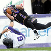 Minnesota State's Kyle Riggott dives over University of Sioux Falls' Brett Jensen while trying to reach the end zone during their game Saturday at Blakeslee Stadium.
