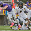 Justin Taormina of Minnesota State breaks a tackle from Wayne State's Terry Sanders and is pursued by Demetrius Stinson (7) in the second half of Saturday's game. The Mavericks won the game 48-27 to finish the regular season 10-0. Photo by Jackson Forderer