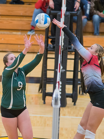 Trust Hering (9) of Waterville-Elysian-Morristown tries to tip the ball past the outstretched arms of Michaela Karels of St. Clair in the Section 2A volleyball tournament. WEM dropped the first game but came back to win 3-1. Photo by Jackson Forderer