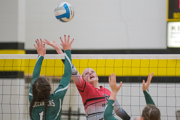 St. Clair's Megan Mettler (6) tries to save the ball from going into the net while Waterville-Elysian-Morristown's Alexis Morsching attempts to block the ball during the Section 2A volleyball tournament played at Mankato East. WEM won the match 3-1. Photo by Jackson Forderer