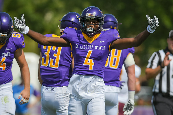 Minnesota State's Larry Moore (4) gets the crowd pumped up after the MSU defense created a turnover against the University of Minnesota Crookston in a game played in Sept. 2017. Photo by Jackson Forderer