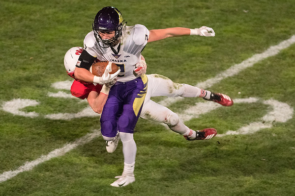 Mankato West's Jon Sikel lays out to tackle Chaska's Colden Dodds after Dodds caught a pass in Friday's Section 2AAAAA playoff game. Photo by Jackson Forderer