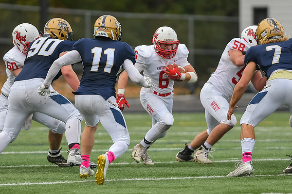 Mankato West's Wyatt Block (6) finds running room in a hole made by the offensive line during the Scarlets' last game against Chanhassen. Photo by Jackson Forderer