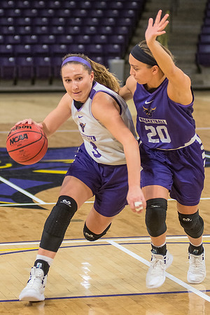 Minnesota State's Monica Muth (left) drives to the basket against teammate Rylee Menster during practice on Tuesday. Photo by Jackson Forderer